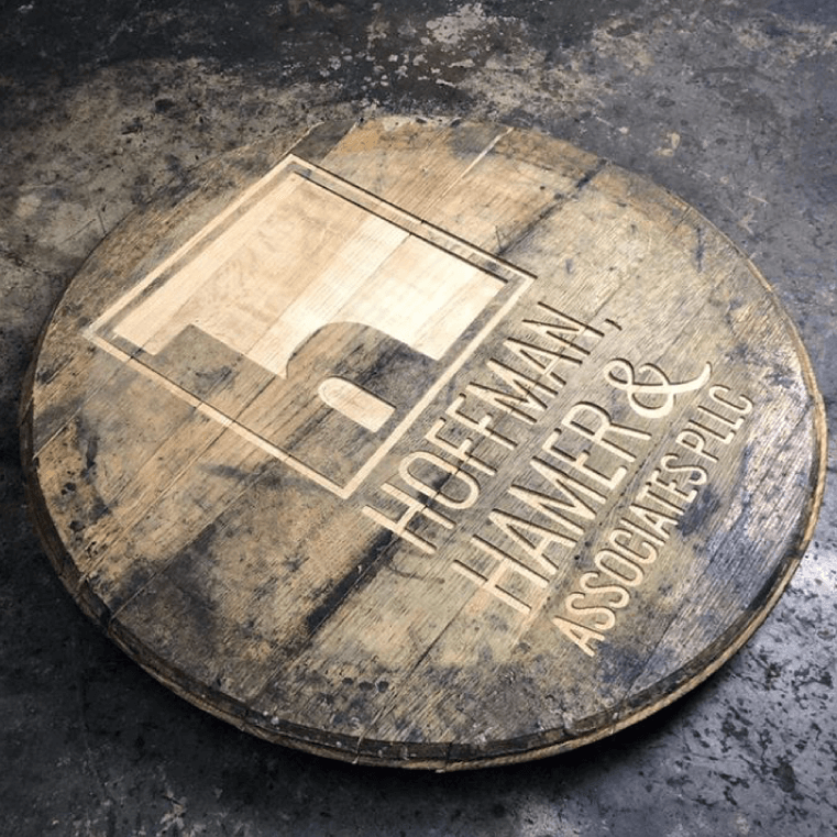 Hoffman Hamer and Associates logo debossed into a barrel top
